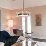 Beautiful modern light fixture installed in a living room by a JSR Electrician.