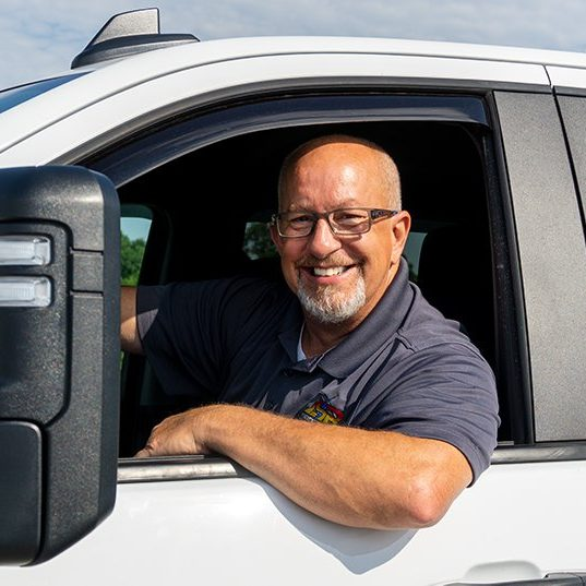 Jeff Reynolds, owner of JSR and a Master Electrician, in one of the JSR service trucks.