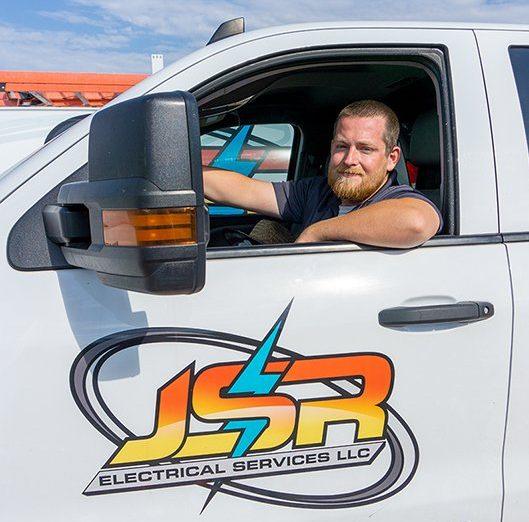 Electrician Zach in JSR Electrical service truck.
