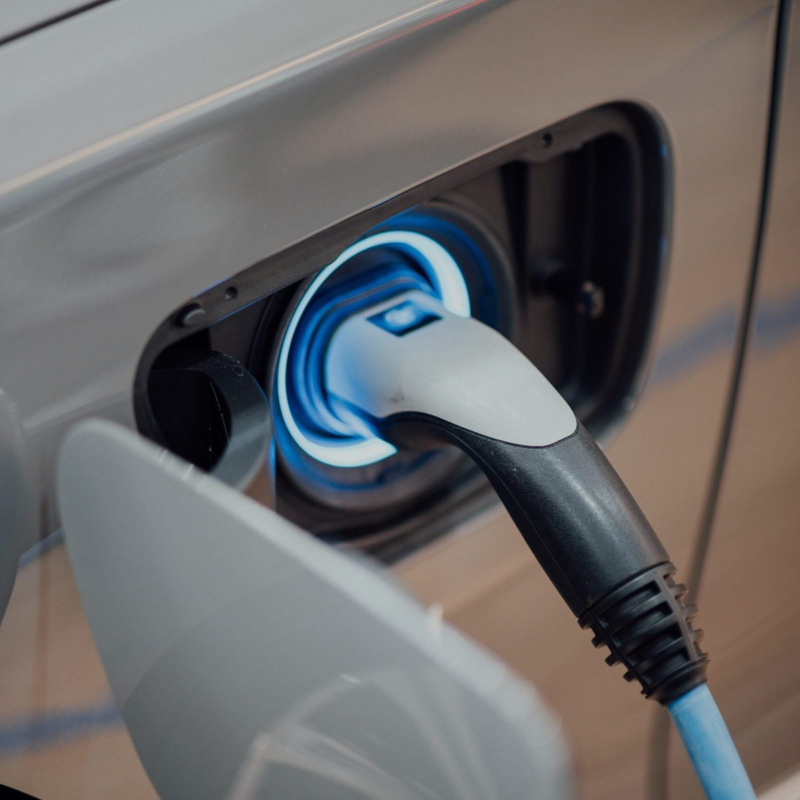 An electric car charger plugged in and getting power.