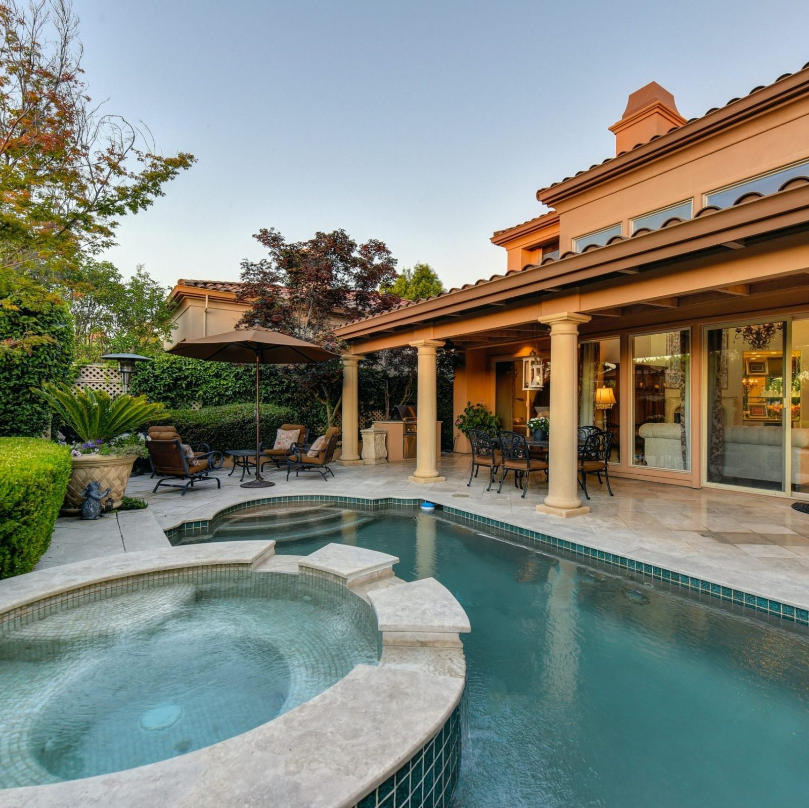 A home with a backyard pool and hot tub spa that is clean, updated, and well maintained.