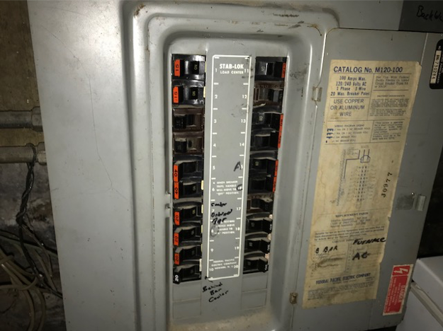 Federal Pacific Electrical Panel with Stab-Lok breakers that is very old and needs to be replaced by an electrician.